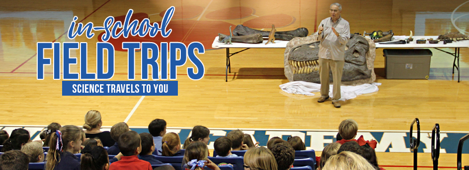 in-school field trip banner with displays of dinosaur fossils